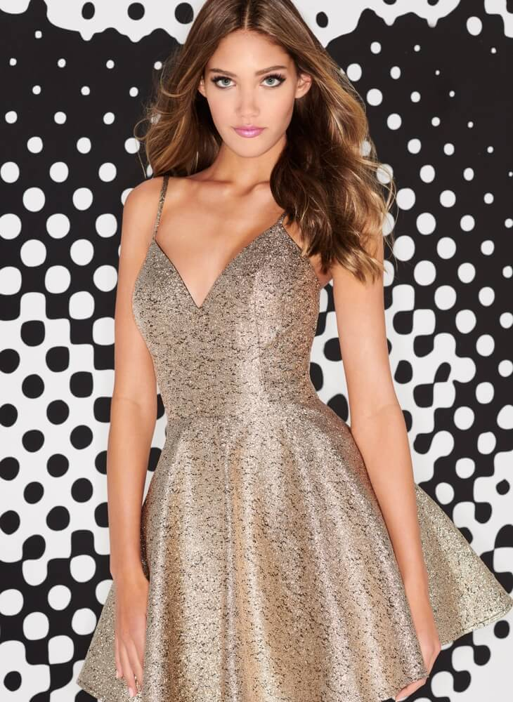Brunette in golden sparkly dress